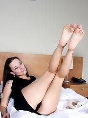 hot brunette making sexy footjob