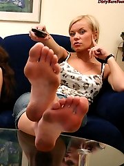 The slave will clean those dusty feet clean while his ladies are watching TV