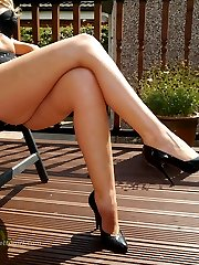 Gorgeous and very leggy Debbie is outdoors in her favourite high stiletto heels