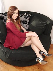 Lovely Lauryn is wearing a pair of shiny nylons and gorgeous black high heel stilettos over her...