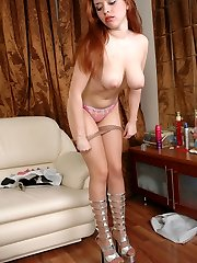 Well-shaped gal taking pleasure while slowly stripping her smooth pantyhose