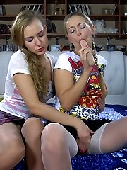 Sweet teen girls flash their cute white and tan stockings while going lesbo