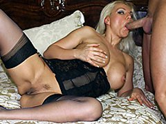 Leggy Lana Cox teases her sexy nylons and then gets her mouth full of big cock