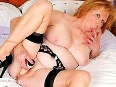 Horny British mature redhead masturbating