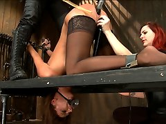 Hot and willing Cassandra wants to get pushed as hard as she can take it. Today is no exception. In a no holds live shoot there is no recanting, breaks, moments she can catch her breath. Nothing. She submits and she endures.First, our bitch du jour is bound in a chair style position as Asa Archer is bound in a standing spread eagle watching. A tall and severe metal neck collar keeps Cassandra tightly in position. Claire adds to the predicament by adding nose and mouth hooks. When Cassandra tries to close her mouth, it pulls on both hooks. Mean clover clamps are added to Cassandra\'s labia and then attached to another set at her nipples. Claire and Mz take turns tormenting and administering pain until immense squirting orgasms are wrenched from this more than eager to cum whore.Next, Cassandra\'s head is bifurcated and trapped under the neck stockade she is kneeling on, with her arms in a very strict strappado. The worst thing about the bifurcation game is never knowing when the pain is going to come and always breaks even the toughest girls. Cassandra crumbles from fear, as expected but its incredibly hot to watch her try and maintain composure over the hell she is enduring. Claire canes and single tails while Mz plays the \
