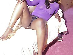 Dark Lovely is a hot black woman who looks great in Purple. Cum join her in her room and see...