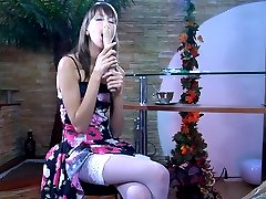 Dark-haired smoker dildo toying in her floral dress and white lacy nylons