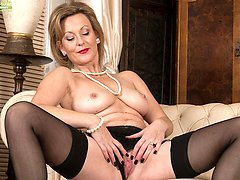 Older babe Huntingdon Smyth naked in only stockings.
