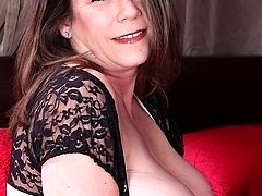Busty wife Jane Russell dildos her older pussy.