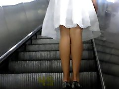 Beauty in a wide white skirt. Beautiful round ass and shaved crotch in a yellow thong. Excellent...