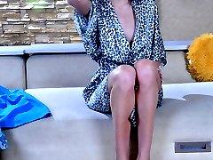 Lovely girl encases her mile-long legs in glamorous white gartered nylons
