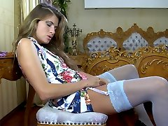 Hot dildo dipper in white suspender nylons rubbing and stuffing her pussy
