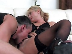 Dolled-up mommy makes her pussy ready for a rock-hard shaft of a hung stud