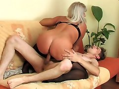 Busty mature gal woken up with a stiff fresh dick into her mouth and beaver