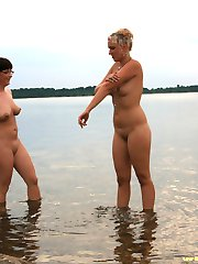 Two crazy girls nude in public