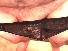 Slipping my black lace panties over my thick cock