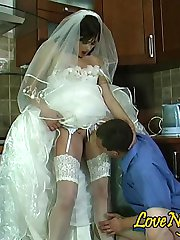 Voluptuous bride in glossy white stockings getting her beaver worked hard