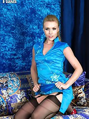 Michelle, stripping from a Chinese theme satin dress, revealing jet black full fashion nylons...