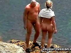 Nudist movies showing acrowd of natural nudists enjoying the sun and the sea