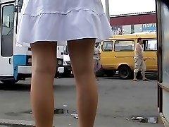 Voyeur up skirts of bimbo in yellow