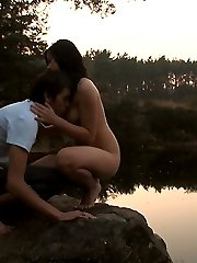 On the edge of the lake, these barely legal teens become one. His cock gently pushes deep inside of her tender pussy, making them both breath hard and softly moan.