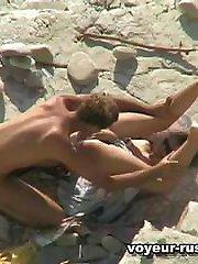 Nudist girl pulls her kneesup to get her bald slit eaten right on the beach