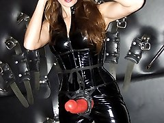 Mistress jane posing in leather outfit with huge strapon cock