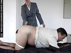 Smart lady in business suit straps guy in pain across his big fat ass
