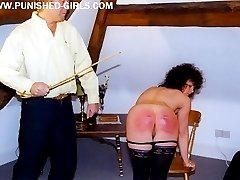Two bare assed babes caned hard across their upturned cheeks