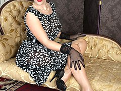 Shay in her fully fashioned nylons and demure frock