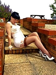 Scarlett our retro gal in vintage ffs, bullet bra and girdle..in the garden!