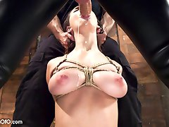 Ashley Adams is an all natural big tit sex addict with a submissive streak that takes her down to the very base of the cock. Ashley's gorgeous tits are tied, whipped, clamped, drooled and slobbered on as she gags down thick gimp dick.When it is time to fuck, Ashley sweats and bounces her fat tits while stuffing her slutty pussy with hard man meat. As a reward for her fine behavior, nipple zippers are torn off as her tight pussy spasms in orgasm. Ashley Adams learns the rough side of servitude on Training of O.
