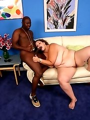 Curly haired bbw Mona Mounds playing with her big rack while humping on top of a black schlong