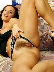 Brunette lady poses with hair on pussy.
