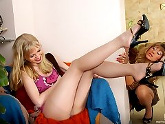 Fiery blondie in suntan pantyhose fingers her pussy while giving tongue job