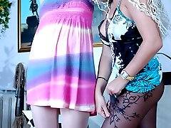 Wearing bright dresses and patterned pantyhose girls go after their pussies
