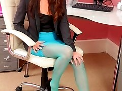 Sexy redhead in turquoise pantyhose