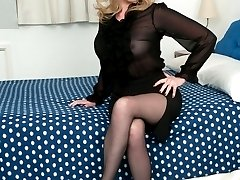 Holly in sheer blouse, tight pencil skirt and sheer to waist black T Bar tights!