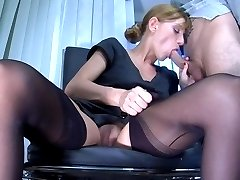 Nasty office babe in seamed stockings sucks her dildo and gets nailed down