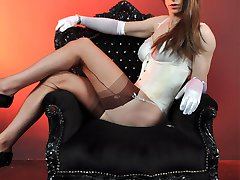 This beautiful horny TGirl loves to be adored on her throne in sexy white lingerie and nylons