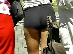 Chick in the tight ass shorts is getting her turning on butt view recorded on spy cam