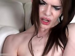 Skinny Tranny Jerks Off with a Bunch of Cum on Her Face