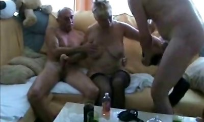 Exhaling onto his cock, she gobbles up each and every inch.