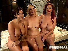 Mz Berlin dominates two large breasted submissives. Lylith Lavey is new to BDSM and looking to push her limits while Alice Frost is a seasoned slave girl who loves to take hard lesbian punishment. Mz Berlin works her magic on both the girls until they give up all their control. Foot worship, ass worship, flogging, spanking, zipper, strap-on anal and humiliation are all included.