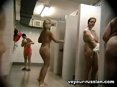 Naked unsuspectingfemales run around shower cabins caught on a secret cam