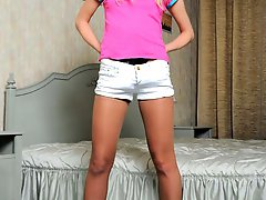 Lonely blonde teen jerks her strap-on thru her tan pantyhose