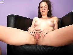 Flexible coed Layla Adams exposes her trimmed pussy.