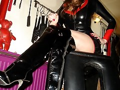 Jane in leather fuck me boots sitting in her dungeon
