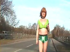 collared tranny bitch whore on the street in hot pants
