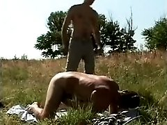 Two hot muscled hunks are fucking hard outdoors